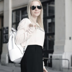 french chic cropped sweater black dress white backpack bowler hat