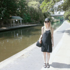 all black outfit for summer swing dress t-bar sandals raffia hat oversized shades