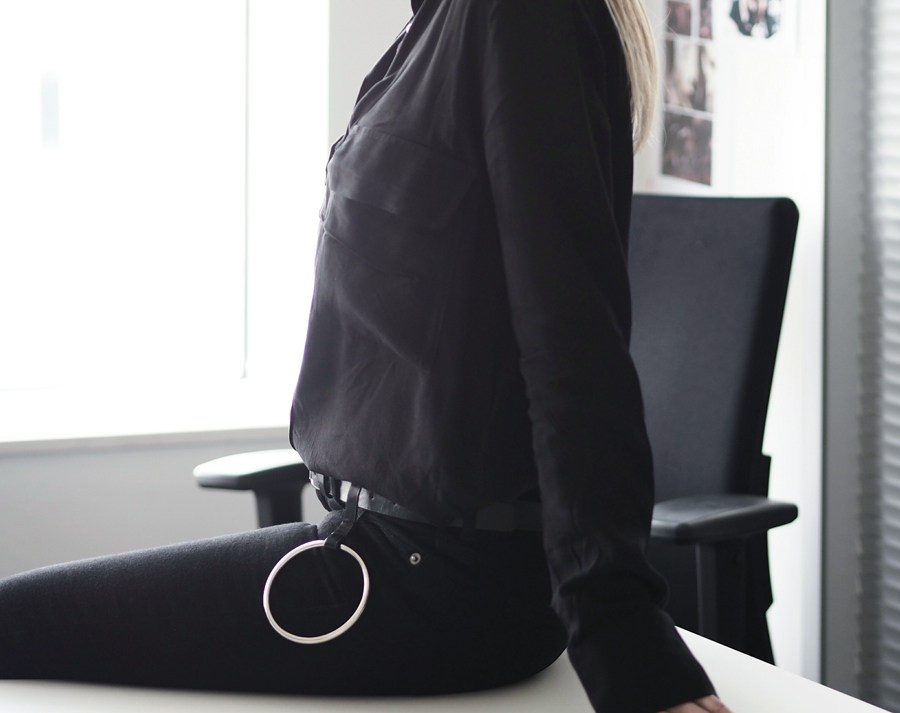 sleek all black minimal outfit raw hem jeans patent pointed fringe hoop detail loafers ray bans flowy utility shirt h&m