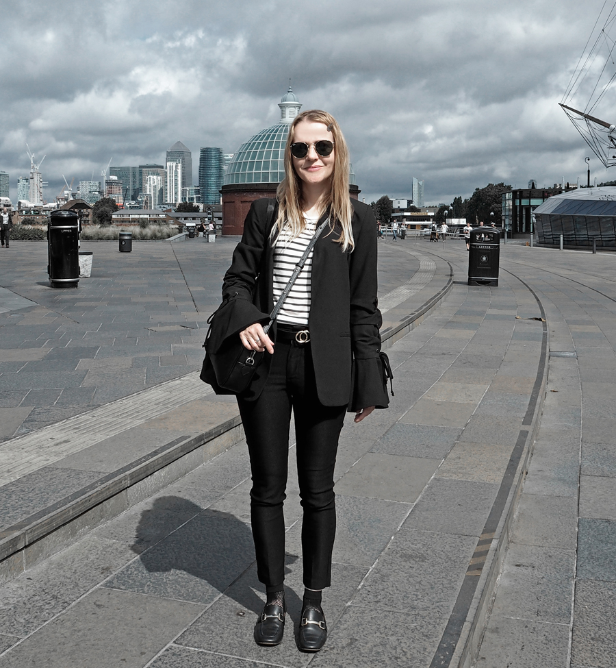 black suit striped tee lace-up bell sleeve blazer cropped trousers loafers mesh socks minimal luxe bag ray-ban