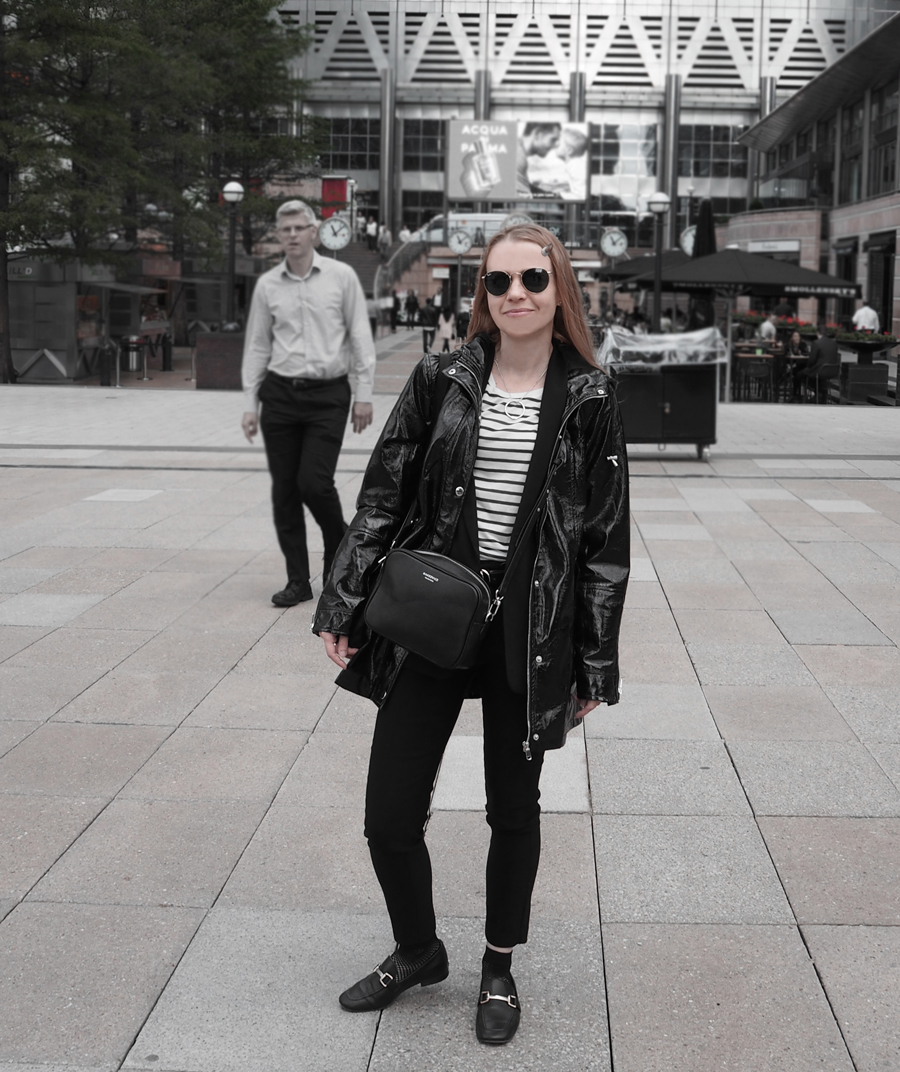 black suit striped tee lace-up bell sleeve blazer cropped trousers loafers mesh socks minimal luxe bag ray-ban vinyl coat